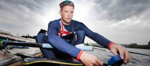 Tom Ford of British Rowing sets his StrokeCoach in his Empacher rowing boat at Caversham