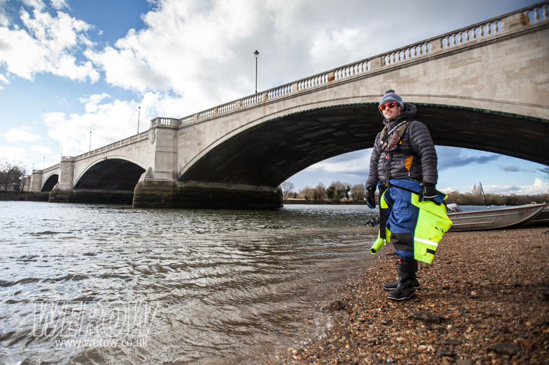 Rowing coach Kieran Clark on the shore of the Thames at Tideway Scullers School, London