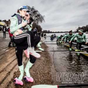 Thea Zabell of CUWBC carries Sophie Shapter to her boat before WEHoRR