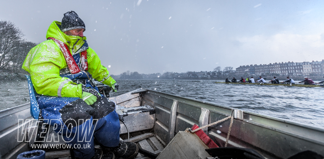 Bobby Thatcher of St Paul's School Boat Club coaching in the snow on the Tideway