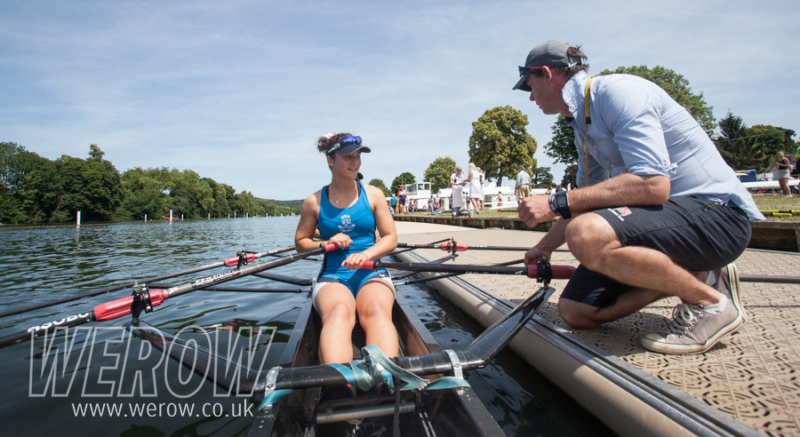 Ray Demaine, head coach at Headington School, talks to Katie Greves and Mattea Wuethrich as they boat at Henley Women's Regatta