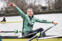 Olivia Coffey trhows a welly out of the CUWBC boat on the tideway