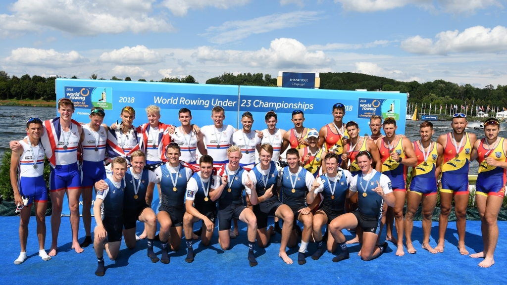 The British Rowing U23 M8+ collecting silver medals at the 2018 World Rowing U23 Championships 2018