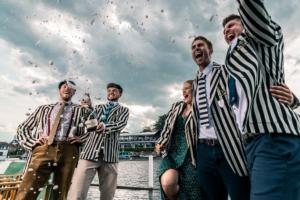 Matt Christie and the Molesey Boat Club four celebrate wining the Britannia Cup at Henley Royal Regatta